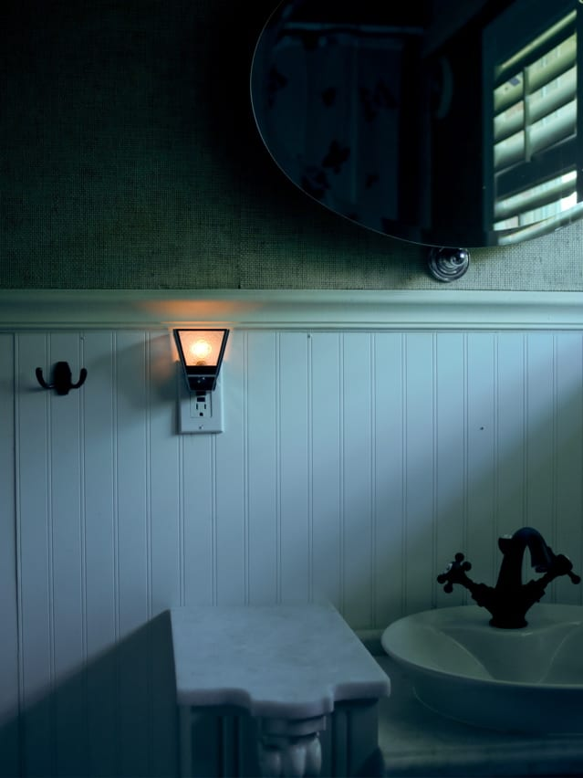 Night light on in dim bathroom | Credit: ARARF