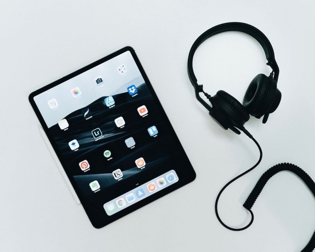 Tablet and headphones sitting on a table