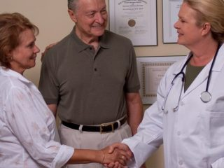 Alzheimer's patient meets with doctor - credit: ARARF